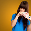 Girl looking through empty popcorn packet — Stock Photo #18816129