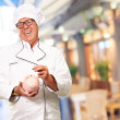 Chef Putting Coin In Piggybank, Indoor — Stock Photo