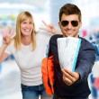 Man Holding Boarding Pass In Front Of Happy Woman Gesturing — Stock Photo