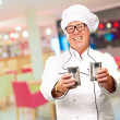 Senior Chef Holding Tin Cans — Stock Photo #18816313