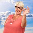 Stock Photo: Senior WomShowing Okay Sign