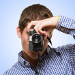 Man Looking Through A Vintage Camera — Stock Photo