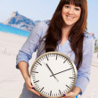 A Young Girl Holding A Clock — Stock Photo #18817083