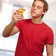 Portrait of a young man eating pizza — Stock Photo #18817481