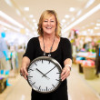 Senior Woman Holding Wall Clock — Stock Photo #18817675