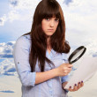 Portrait Of A Girl Holding A Magnifying Glass And Paper — Stock Photo #18817731