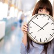 Woman Holding Clock — Stock Photo #18817771