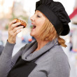 Portrait Of A Woman While Eating Pastry — Stock Photo