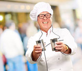 Portrait Of A Chef Holding Tin Cans — Stock Photo
