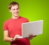 Happy man using laptop — Stock Photo