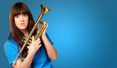 Confused woman holding trumpet — Stock Photo