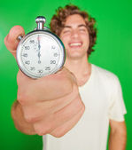 Man holding a stopwatch — Stock Photo