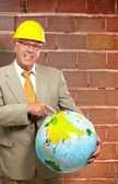 Happy Male Architect Pointing On Globe — Stock Photo