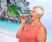 Senior Woman Talking On Metal Tin Can Phone — Stock Photo