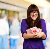 Woman Holding Empty Popcorn Packet — Stock Photo