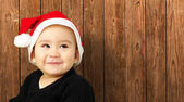 Baby boy smiling and wearing a christmas hat — Stock Photo