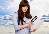 Portrait Of A Girl Holding A Magnifying Glass And Paper — Stock Photo