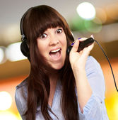 Girl With Headset Singing On Mike — Stock Photo