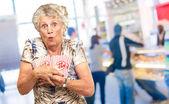 Portrait Of Mature Woman Holding Popcorn — Stock Photo