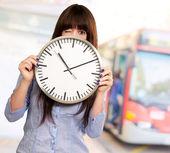 Woman Holding Clock Winking — Stock Photo