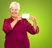 Old Woman Showing Paper — Stock Photo