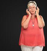Sad Senior Woman With Headset — Stock Photo