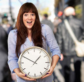 A Young Girl Holding A Clock — Stock Photo