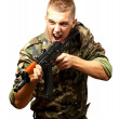 Portrait of an angry soldier aiming — Stock Photo #19515151