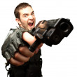 Angry Soldier Holding Gun — Stock Photo #19515243