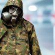 Stock Photo: Angry soldier wearing gas mask