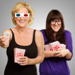 Mother And Daughter Enjoying 3d Movie - Stock Photo