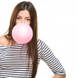 Portrait Of A Young Woman Blowing Bubblegum — Stock Photo #19517801