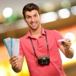 Man holding boarding pass and airplane — Stock Photo #19518217