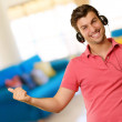 Young man wearing headphones — Stock Photo #19518281