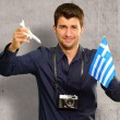 Photographer Holding Greece Flag And Miniature Airplane - Stock Photo