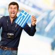 Man holding flag and miniature airplane — Stock Photo #19518693