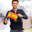 Portrait of a young man holding a flag - Stock Photo