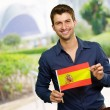 Young Man Holding Spain Flag - Stock Photo