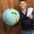 Portrait Of A Happy Young Man With Globe And Boarding Pass - Stock Photo