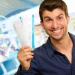 Stock Photo: Portrait Of A Young Man Holding Boarding Pass