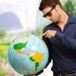 Young Man Wearing Goggle Showing Destination - Stock Photo