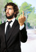 Portrait Of An Unhappy Businessman Pointing Up — 图库照片
