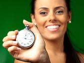 Portrait of a beautiful woman holding a stopwatch — Stock Photo