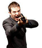 Angry Man Holding Gun — Stock Photo