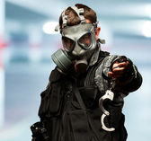 Soldier With A Gas Mask Holding Handcuffs — Stock Photo