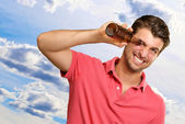 Man looking inside an empty bottle — Stock Photo