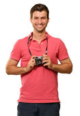 Portrait of a man holding camera — Stock Photo