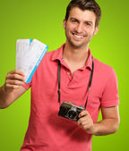 Portrait Of Man Holding Camera And Boarding Pass — Stock Photo