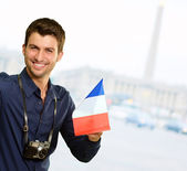 Young Man With Flag And Camera — Stock Photo