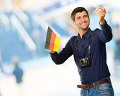 Photographer Holding German Flag And Miniature Airplane — ストック写真